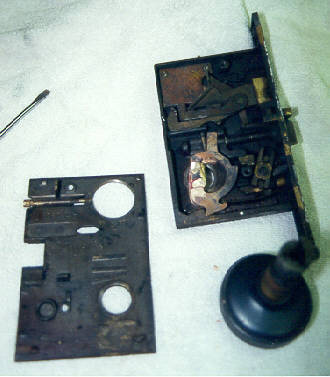 This lock was repaired and parts were made to restore it to working condition