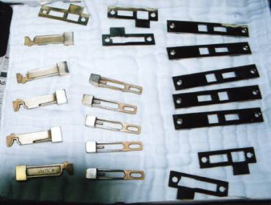 Lock parts dissassembled and brass plated